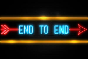 End To End - fluorescent Neon Sign on brickwall Front view